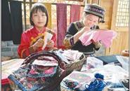 《人民日报》以柳州为例,报道《古老非遗,渐成扶贫生力军》